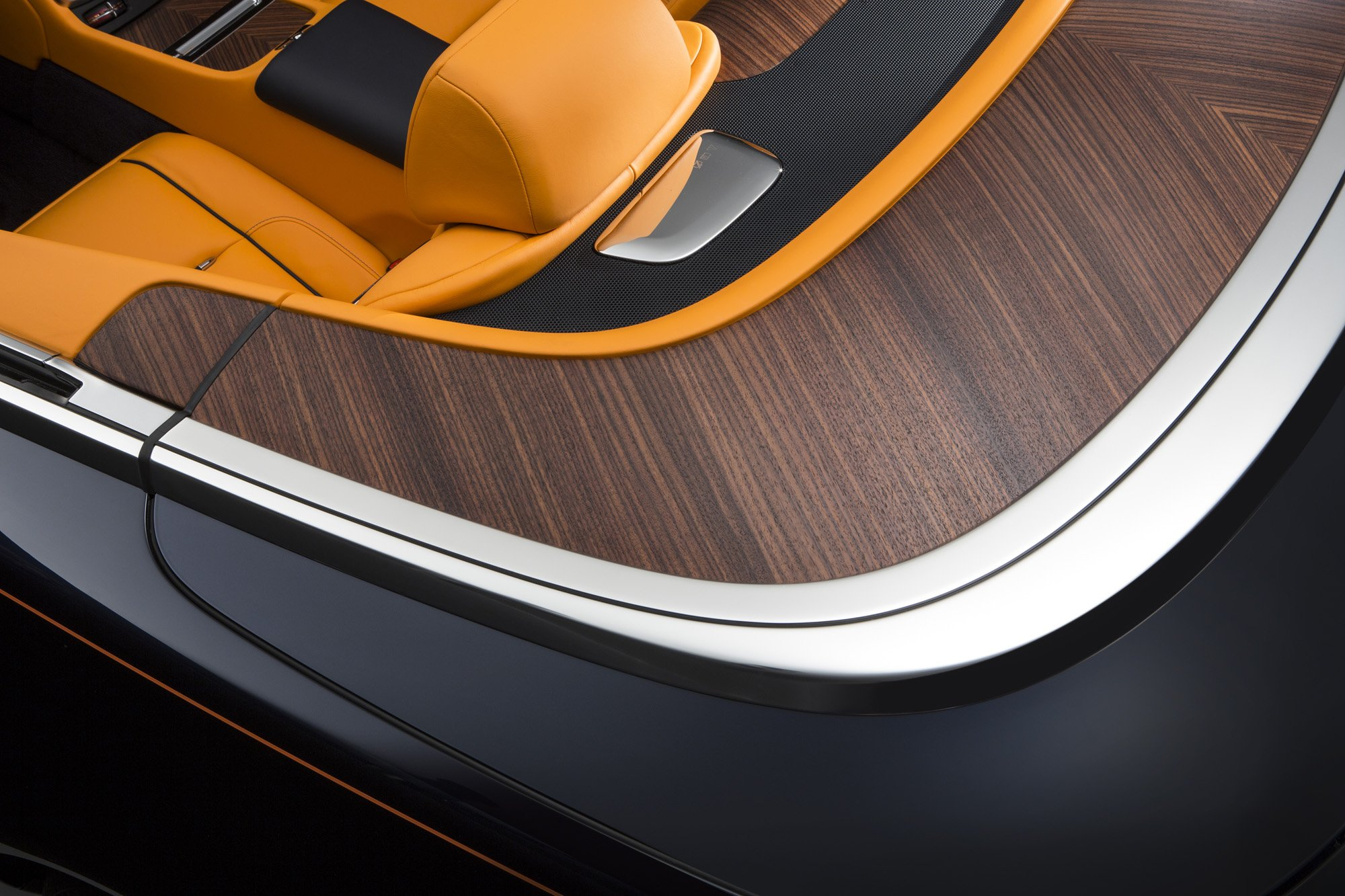 Rolls-Royce 2015 Drophead Dawn, here showing the hand crafted mirror-matched open pore wood rear deck cover shows attention to craft and detail