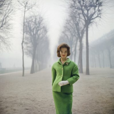 Henrietta Tiarks Among The Trees' sees Mark Shaw capture the Duchess of Bedford as she models a green suit by Jules François Crahay of Nina Ricci at Palais Royale, Paris 1959. Copyright © Mark Shaw/mptvimages.com