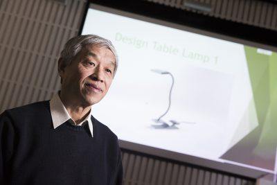 Professor Daizhong Su from Nottingham Trent University and the lamp designed for this project
