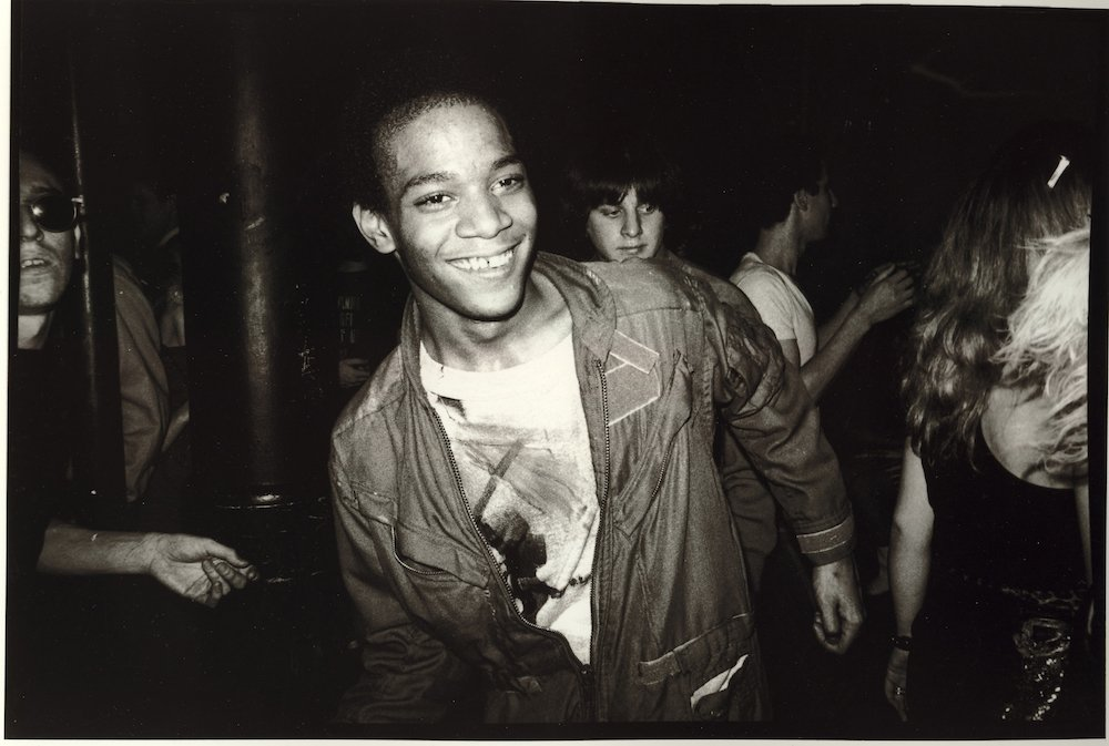 Jean-Michel Basquiat dancing at the Mudd Club with painted t-shirt, 1979 © Nicholas Taylor