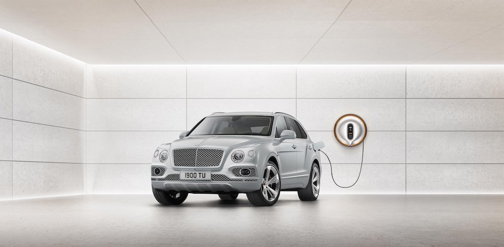 Bentayga Hybrid being charged by Bentley by Starck Power Dock