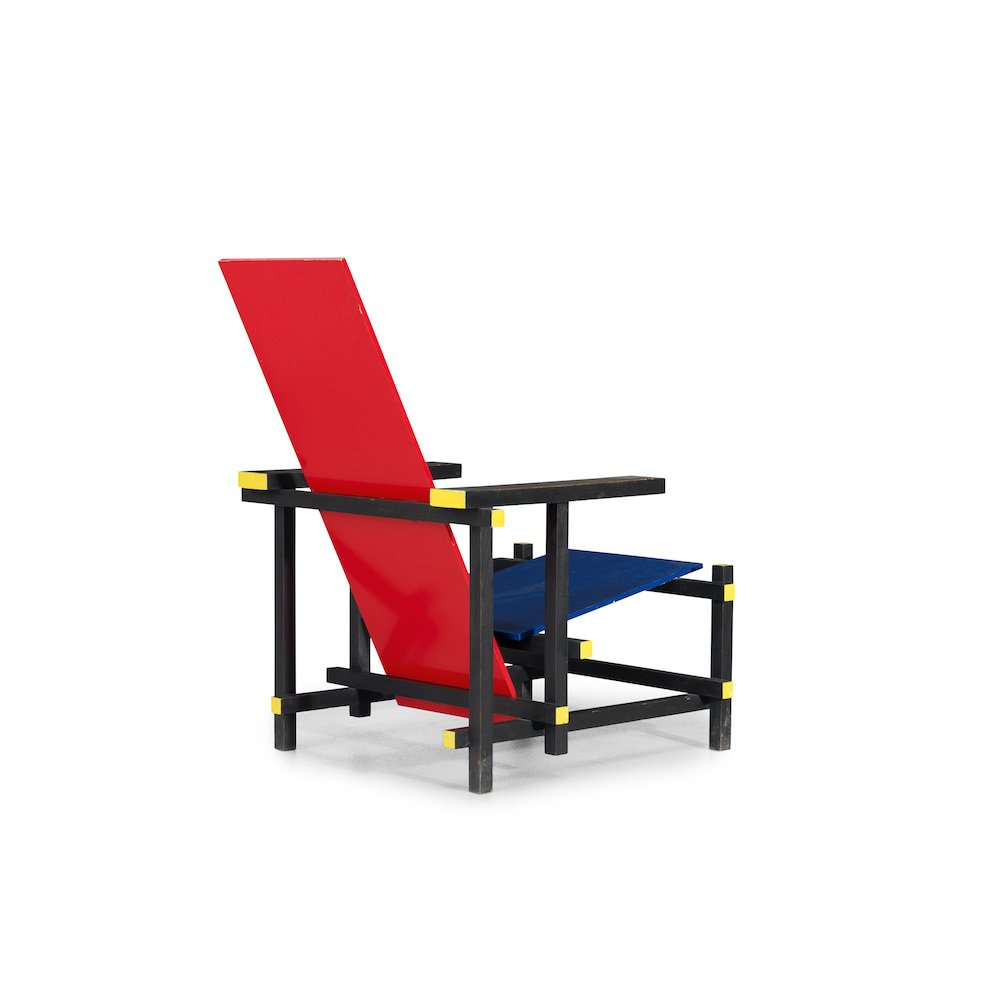 Gerrit Rietveld's iconic Red & Blue chair, designed in 1918, produced by Cassina in stained pine and plywood Courtesy Wright, wright20.com
