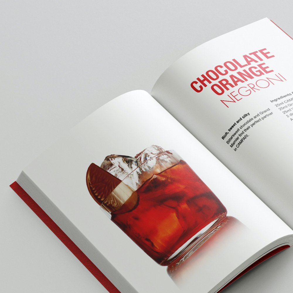 The Little Red Book of Campari Serves & Negroni Twists created by Spinach Branding for Campari at LaVitaCampari.com